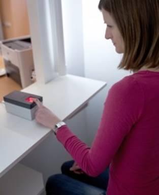 Ladys hand on biometric readers